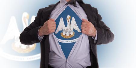 louisiana flag: Businessman rips open his shirt to show his Louisiana flag t-shirt