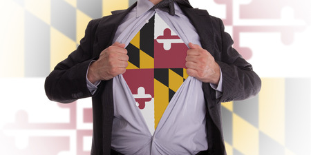 maryland flag: Businessman rips open his shirt to show his Maryland flag t-shirt Stock Photo