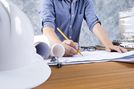 architect tools: Architect or engineer working on blueprint, Construction and engineering concept. Engineering tools. Stock Photo