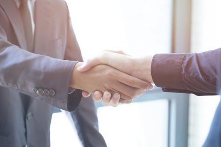 handclasp: Businessmen handshake; success, dealing, greeting & business partner concepts - soft focus Stock Photo