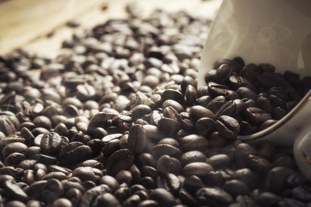 golden bean: The coffee cup and coffee beans.