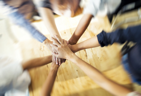 Business group with hands together - teamwork concepts Banco de Imagens - 58726243
