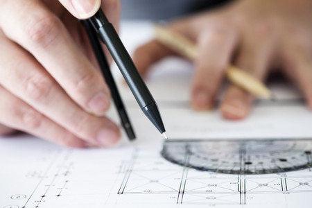 architect tools: Architect or engineer working on blueprint, Construction concept. Engineering tools.