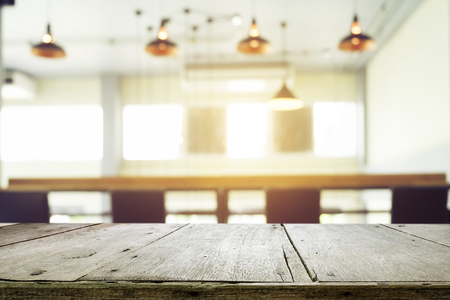 copysapce: Empty wood table or floor with blur coworker place coffee cafe shop restaurant bokeh background. Product display template. Business presentation.