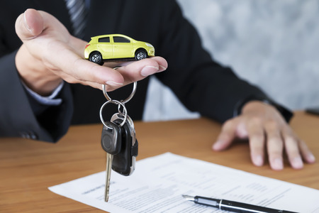 Business concept, car insurance, sell and buy car, car financing, car key for Vehicle Sales Agreement. Standard-Bild