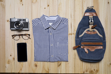 rimmed: Still life of casual man. Hipster style on wood background.