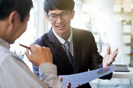 Image of business partners discussing documents and ideas at meeting. Business team situation of present and share idea. Stock Photo