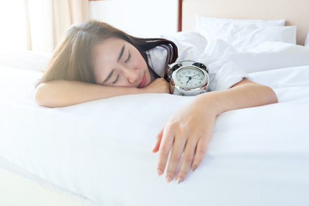 gir: Woman sleep on bed in the morning. Lazy to wake up and want to relax on bed.
