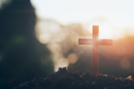 cross on blurry sunset background. Christian, Christianity, Religion copyspace background. Archivio Fotografico