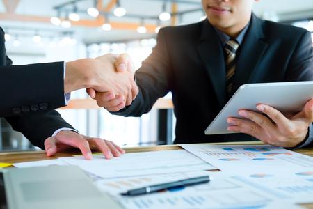 Businessmans handshake. Business partnership meeting concept. Successful businessmen handshaking after good deal. Standard-Bild