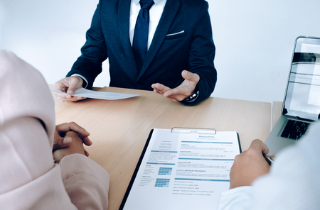 seeker: Business situation, job interview concept. Job seeker present resume to managers. Stock Photo