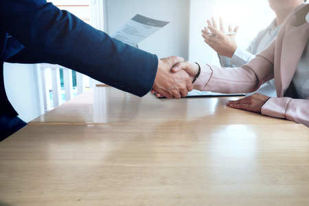 seeker: Business situation, job interview concept. Business people handshake success deal.  Stock Photo