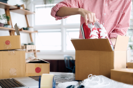 Business Start up SME concept. Young startup entrepreneur small business owner working at home, packaging and delivery situation. Standard-Bild
