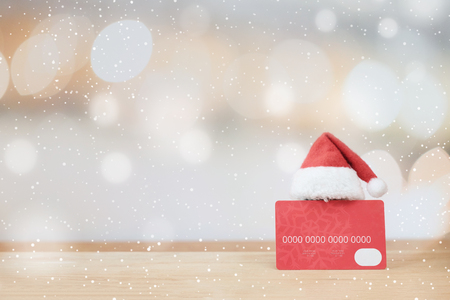 Christmas shopping idea concept background. Credit card and Santa Claus hat on bokeh background; Banco de Imagens - 89054897