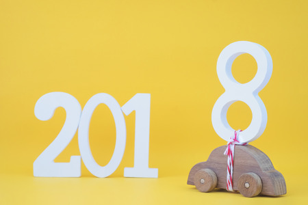 todo list: 2018 Happy New Year  idea concept on yellow background.