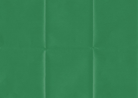 Retro green paper folded texture background.