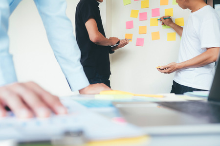 Team of Designer working at office. Designers brainstorming meeting team. Stock Photo