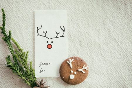 Christmas card and homemade gingerbread cookie on table. Christmas food and background.
