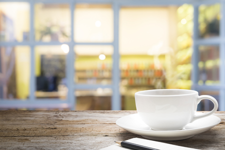 Empty table for present product on blur background of coffee cafe.