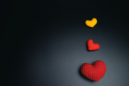 Love Valentine idea background concept. Hearts on black background. Stock Photo