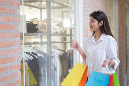 Business, Lifestyle, Consumerism and Shopping concept.  Happy woman with shopping bags enjoying in shopping.
