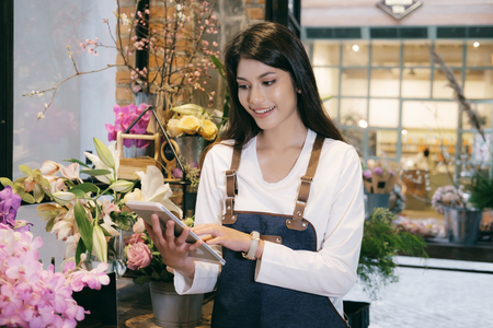 Confident Young Business Owner Flower Shop Store Florist Botany Bouquet Blooming. Stock Photo