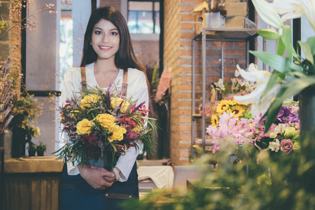 Confident Young Business Owner of Flower Shop Store holding flower