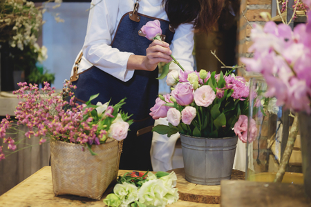 Confident Young Business Owner of Flower Shop Store arranging flower Stock Photo