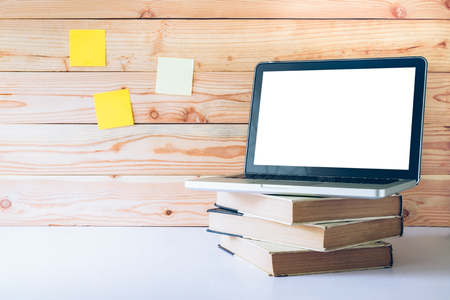 Mock up blank white screen laptop. Working space and white screen laptop. Stock Photo