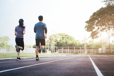 Young couple jogging workout in the morning. Healthy lifestyle concept.