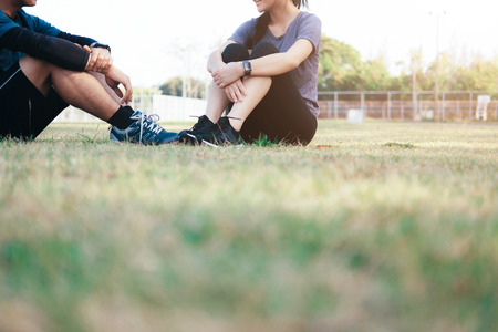 Happy fit young couple relaxing after physical training session. Stock Photo
