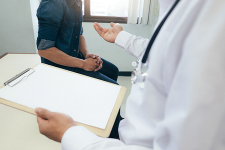 Doctor and patient are discussing something. Health care , Hospital and Doctor concept. Stock Photo