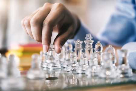 Businessman playing chess game. Business strategy and planning concept. Stock Photo