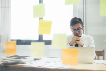 Young Startup Businessman thinking and analyse planing the business strategy  Stock Photo