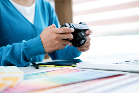 Graphic designer and Photographer working on computer and used graphics tablet. Stock Photo
