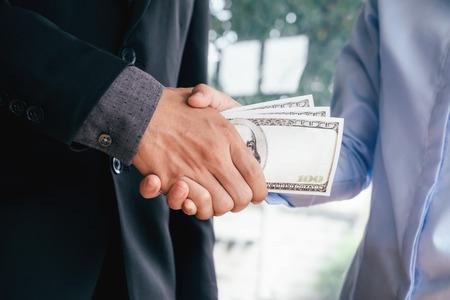 Bribery and corruption concepts. Businessman receive money.