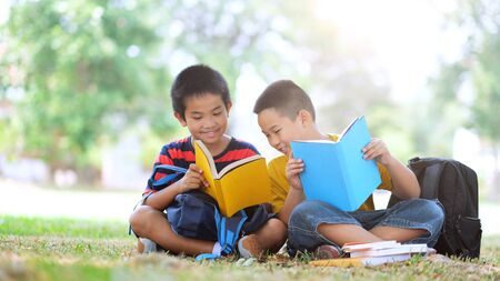 Back to school and education concept. Two boys of primary reading and doing homework together.