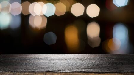 Empty wooden table for present product on coffee shop or soft drink bar blur background with bokeh image.  写真素材