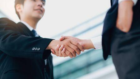 Businessmans handshake. Successful businessmen handshaking after good deal. Business partnership meeting concept.