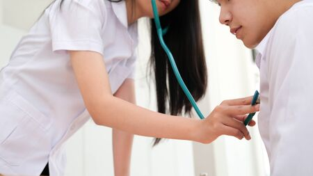 Doctor checking patient. Doctor examines a patient with a stethoscope. Health, Hospital and Medical concept.