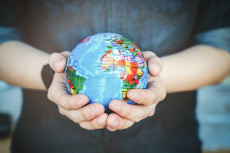 Protect our world in human hands. Human hands holding Green planet , Save earth concept.