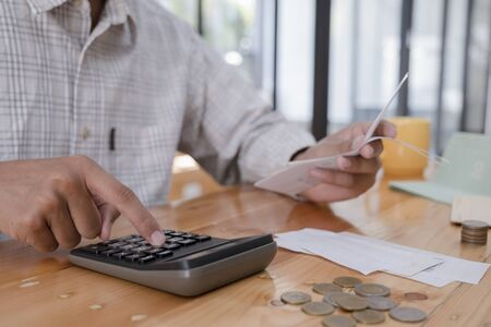 Finances Saving Economy concept. Accountant or banker calculate the cash bill. Фото со стока - 137996899