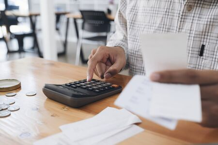 Finances Saving Economy concept. Accountant or banker calculate the cash bill. Stock Photo