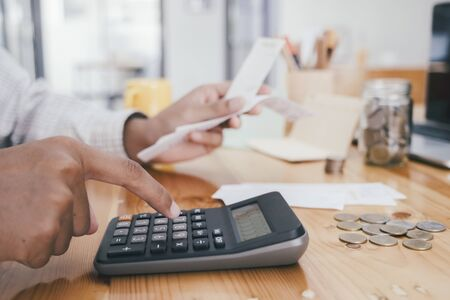 Finances Saving Economy concept. Accountant or banker calculate the cash bill. Фото со стока