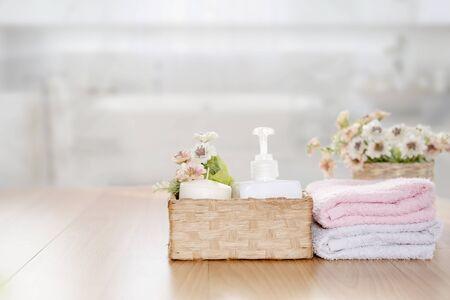 Towels on wooden top table with copy space on blurred bathroom background. For product display montage. Фото со стока