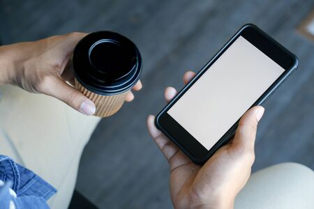 Close up of man hand holding smart phone. Blank screen mockup for graphics display montage. Фото со стока