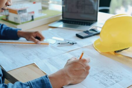 Architect or engineer working in office, Construction concept. Engineering tools.