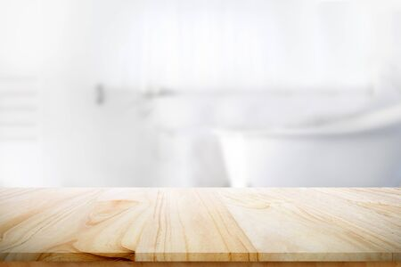 Empty wooden top table with blurred bathroom background for product display montage.