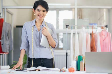 Portrait young woman tailor design owner shop. Business owner shop and entrepreneur concept.