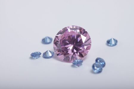 Macro shoots of a group of diamonds that has different shapes, heart, round, pear, asscher, oval, princess, isolated background Foto de archivo